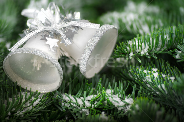 Silver Christmas bells on fir twigs Stock photo © Smileus