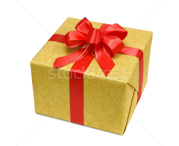Gold gift box with smart red bow Stock photo © Smileus