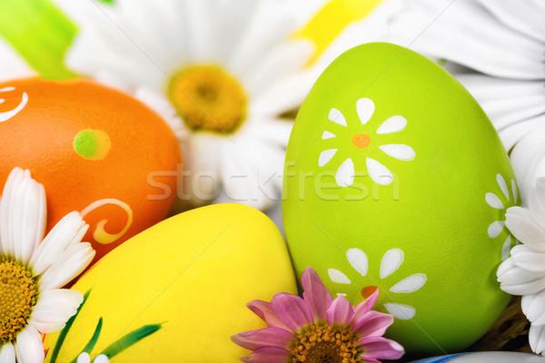 Easter eggs and flowers closeup Stock photo © Smileus