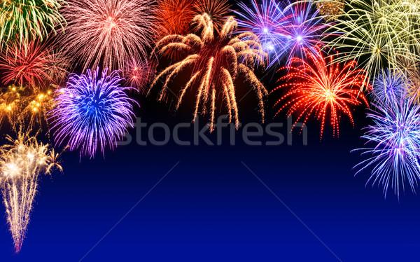 Fireworks display on dark blue Stock photo © Smileus