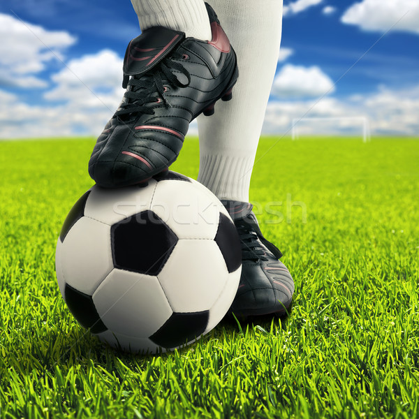 Soccer player's feet in casual pose Stock photo © Smileus