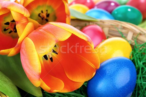 Kleurrijk Pasen arrangement oranje tulpen veelkleurig Stockfoto © Smileus