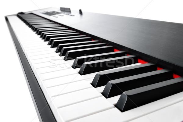 музыкальный клавиатура белый музыку инструмент Сток-фото © Smileus