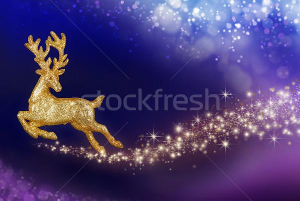 Christmas magic with golden reindeer Stock photo © Smileus