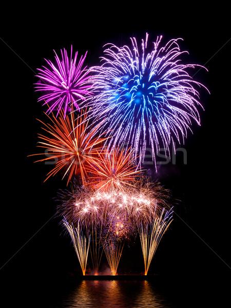 Wspaniały fajerwerków Widok szczęśliwy kolory czarny Zdjęcia stock © Smileus