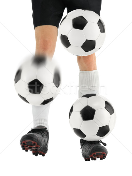 Juggling three soccer balls with the feet Stock photo © Smileus