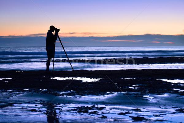 Photographer at the sea in the dusk Stock photo © Smileus