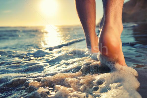 Enjoying a barefooted walk at the ocean Stock photo © Smileus