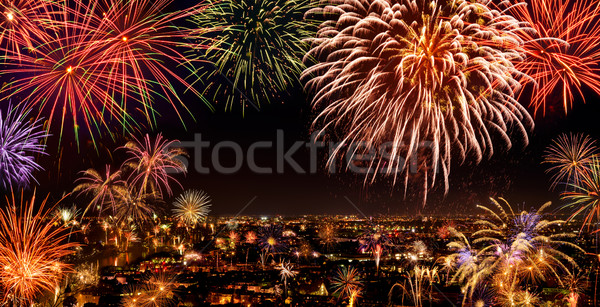 Whole city celebrating with fireworks Stock photo © Smileus