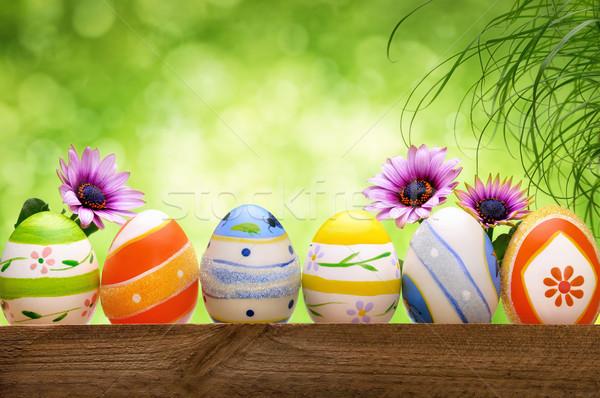 Stok fotoğraf: Paskalya · yumurtası · çiçekler · bokeh · renkli · dekore · edilmiş