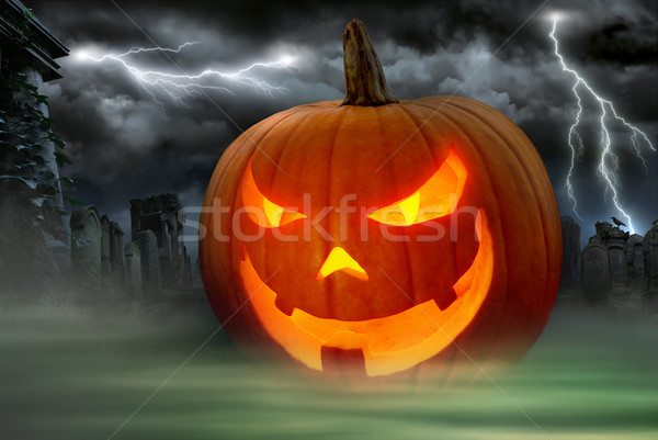Creepy Jack o Lantern in a misty graveyard Stock photo © Smileus