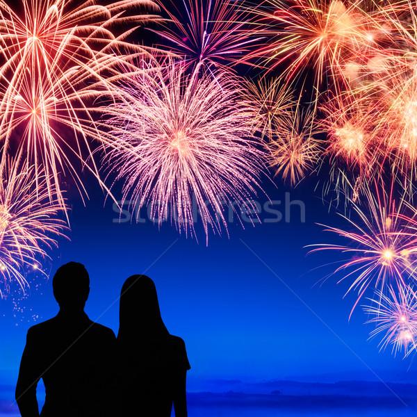 Couple enjoying a fireworks display Stock photo © Smileus