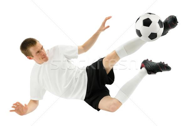 Geschoold voetballer geïsoleerd bal Stockfoto © Smileus