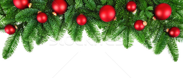 Lush fir twigs and red baubles on white Stock photo © Smileus
