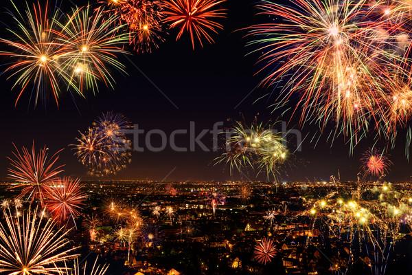 Geheel stad vieren vuurwerk nieuwjaar evenement Stockfoto © Smileus