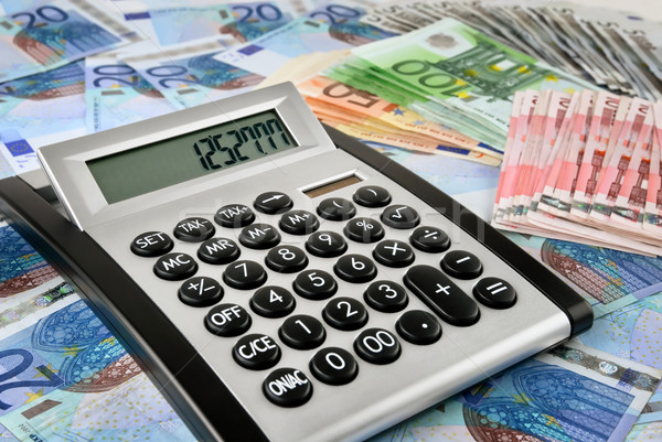 Office calculator on Euro banknotes Stock photo © Smileus