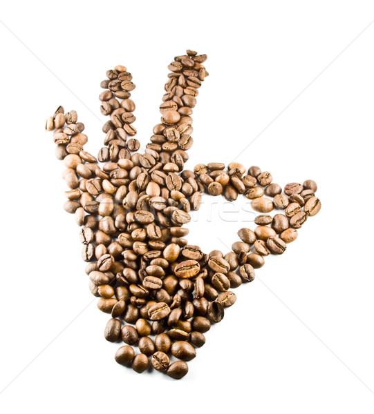 hand making OK made of beans on white background Stock photo © smoki