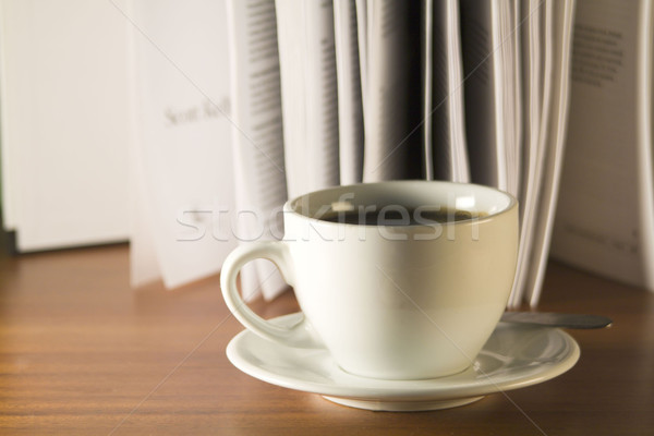 Coffee and books on a wooden table Stock photo © smoki