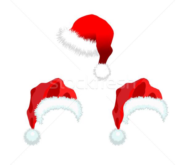 Three red Santa Claus Hat Stock photo © smoki