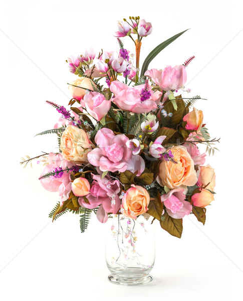 Bouquet of rose and Narcissus in glass vase Stock photo © smuay