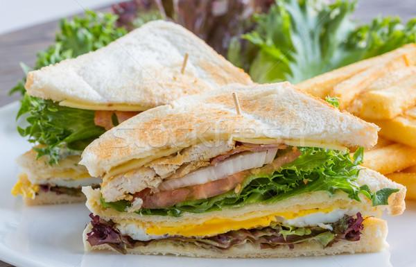 трехслойный бутерброд большой служивший французский жареный растительное Сток-фото © smuay