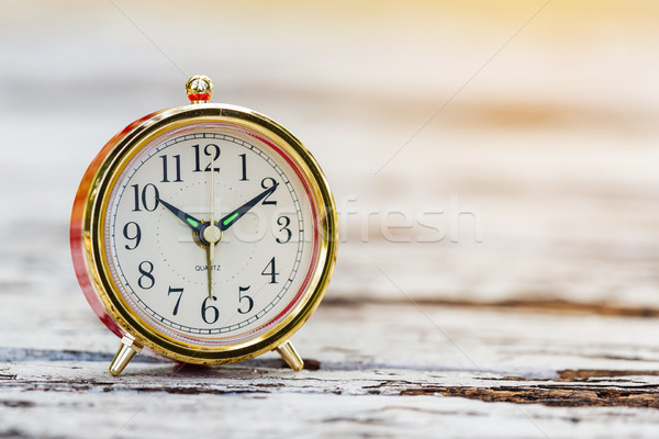 Alarm clock on wooden table Stock photo © smuay