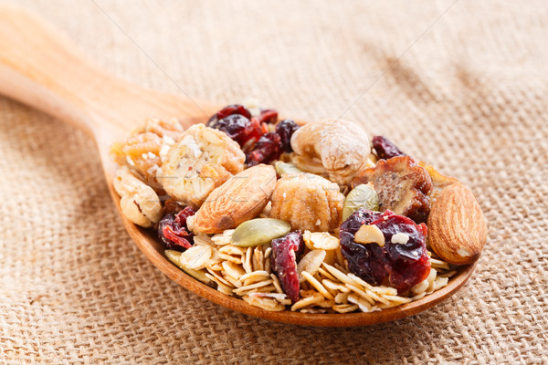 Granola or muesli in wooden spoon Stock photo © smuay