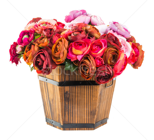 Bouquet od reses in wood bucket Stock photo © smuay