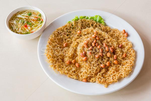 Crispy catfish salad with green mango Stock photo © smuay