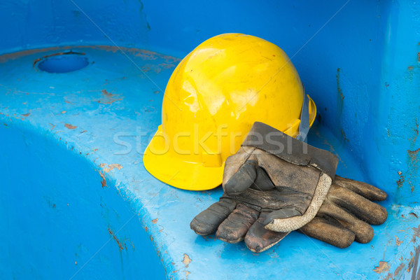 Dirty leather gloves and safety helmet Stock photo © smuay