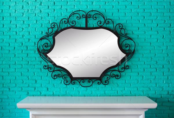 Asztal tükör fekete keret zöld téglafal Stock fotó © smuay