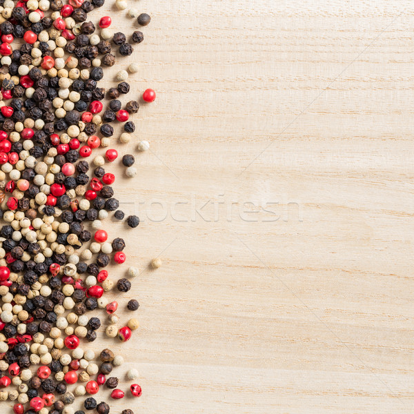 Colorful peppercorn on wooden background Stock photo © smuay