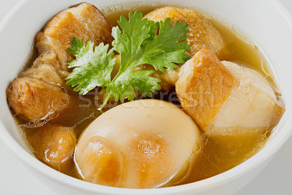 Sweet pot stewed streaky pork and egg with five spices Stock photo © smuay