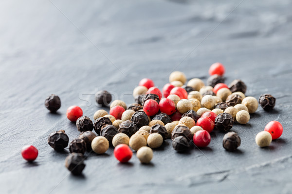 Colorful peppercorn on stone background Stock photo © smuay