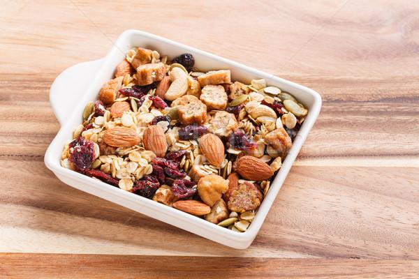 Granola or muesli in ceramic bowl Stock photo © smuay