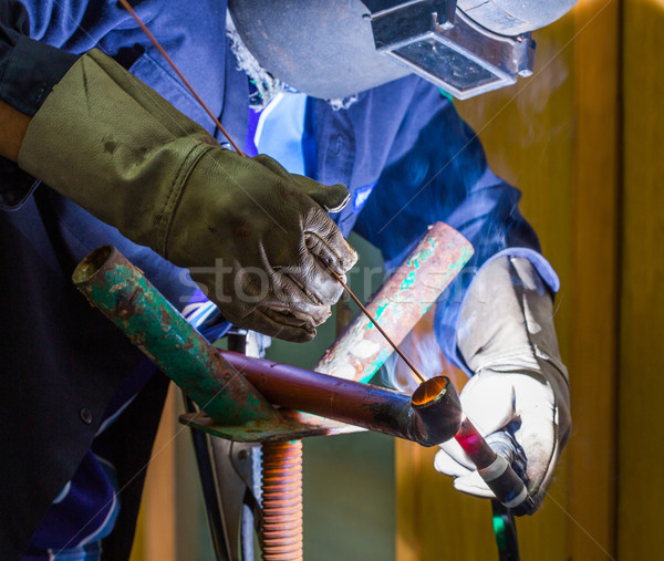 Soudage travailleur fer pipe machine homme Photo stock © smuay