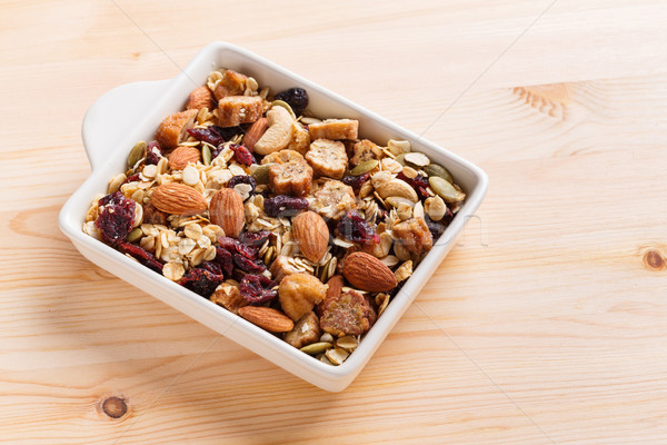 Granola muesli céramique bol table en bois Photo stock © smuay