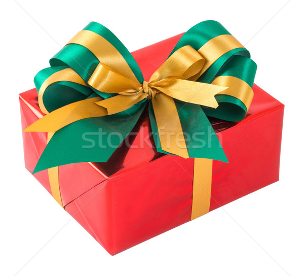 Red gift box with green and gold bow tie Stock photo © smuay