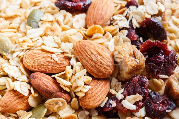 Granola muesli table en bois mélange de fruits aliments sains Photo stock © smuay