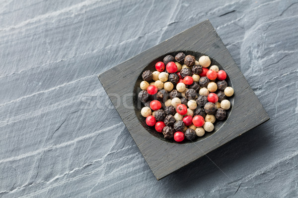 Colorful peppercorn in wooden bowl Stock photo © smuay