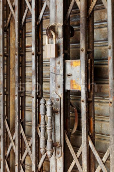 Old and rusty steel shutter door handle Stock photo © smuay