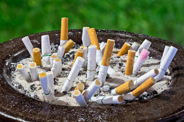 сигареты прикладом пепельница изолированный зеленый здоровья Сток-фото © smuay