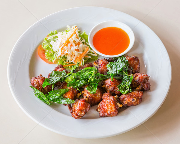 Deep Fried chicken wings with chili sauce Stock photo © smuay