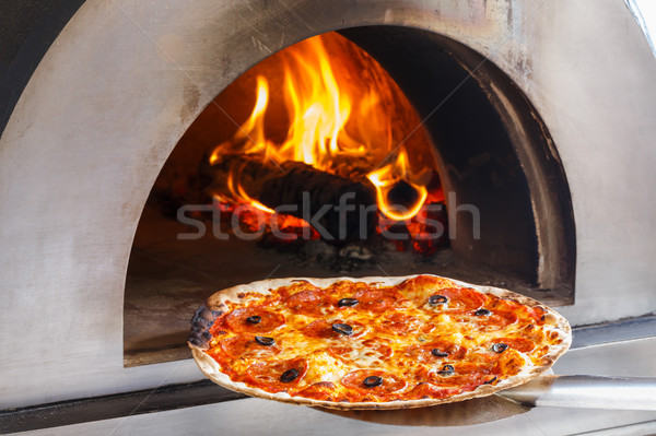 Fire oven pizza Stock photo © smuay