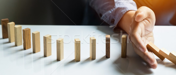businessman hand stop dominoes continuous toppled, Panoramic com Stock photo © snowing