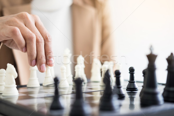 Businesswomen playing chess game makes her move Stock photo © snowing