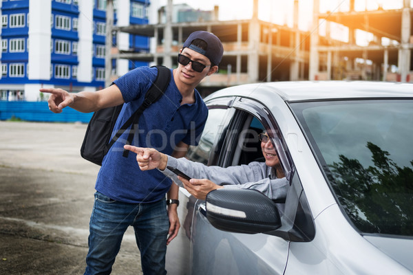 tourists or traveler seek advice map with smart phone from taxi  Stock photo © snowing