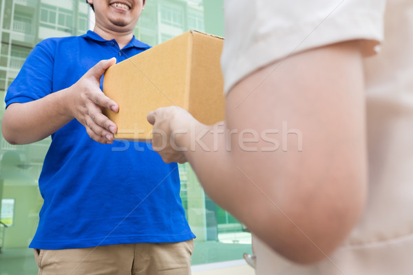 Postal - delivery of a package through a  service; Woman custome Stock photo © snowing