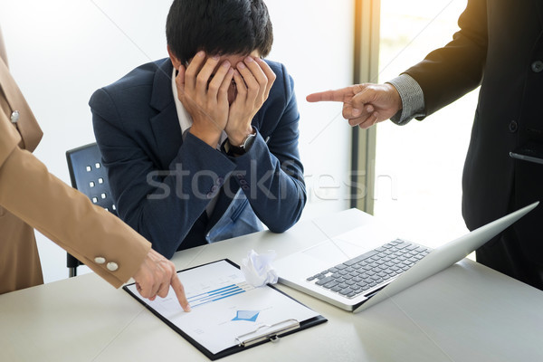 Group Of Angry Business people Blaming Male Colleague In Meeting Stock photo © snowing