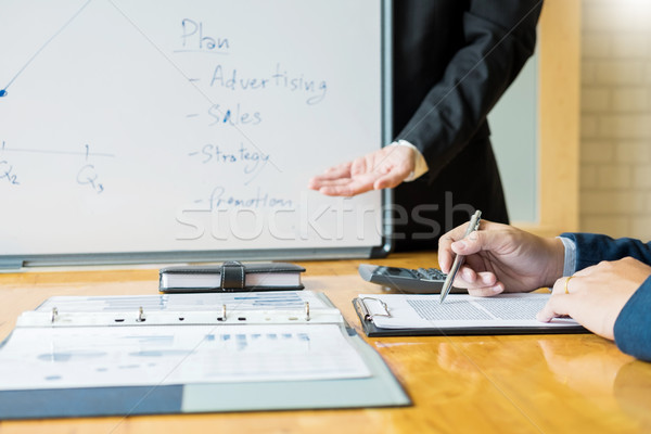 Male manager expressing ideas on whiteboard meeting talk to Stra Stock photo © snowing